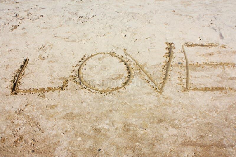 L'iscrizione sulla sabbia fotografia stock