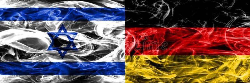 L'Israël contre des drapeaux de fumée de l'Allemagne placés côte à côte Israélien et G illustration libre de droits