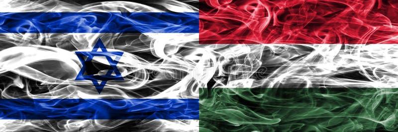 L'Israël contre des drapeaux de fumée de la Hongrie placés côte à côte Israélien et H illustration libre de droits