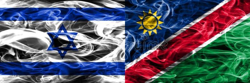 L'Israël contre des drapeaux de fumée de la Namibie placés côte à côte Israélien et N illustration libre de droits