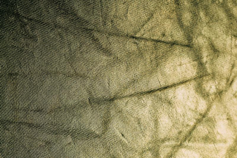 L'or jaune a monnayé la texture brillante de tissu de vintage, fond abstrait photo stock