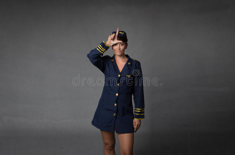 L for a loser hostess. Dark background royalty free stock photo