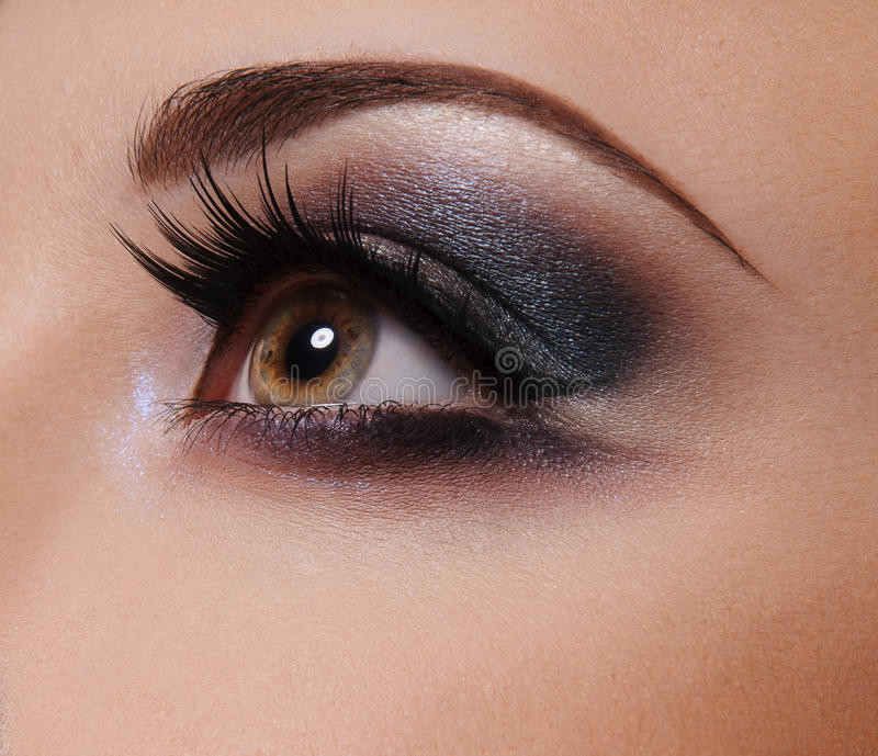 L'occhio del fascino compone vicino su immagini stock