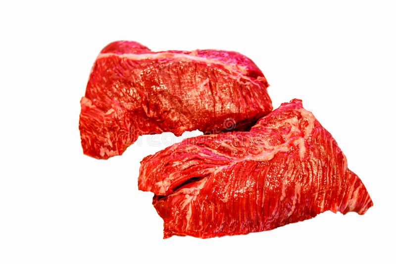L'offre accrochante de bifteck est sur un fond blanc photographie stock