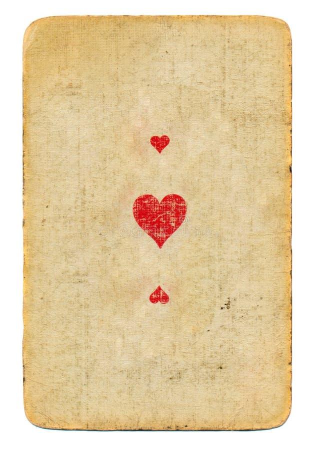 L'oggetto d'antiquariato ha usato l'asso della carta da gioco del fondo di carta dei cuori con tre simboli fotografia stock libera da diritti