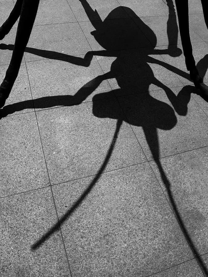 L'ombra di una formica gigante immagini stock libere da diritti