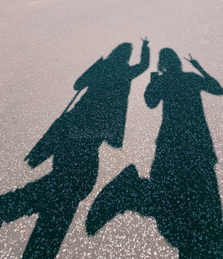 L'ombra vuole una foto! immagine stock libera da diritti