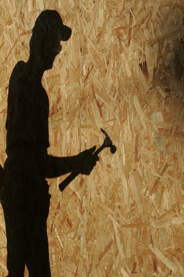 L'ombre du travailleur de la construction photos libres de droits