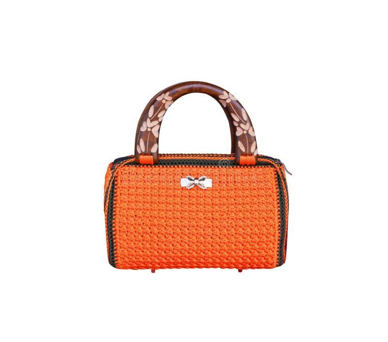 L'orange colorée avec le crochet noir de bord a tricoté le sac à main et la décoration avec l'arc blanc de bijoux, fait à partir  image stock