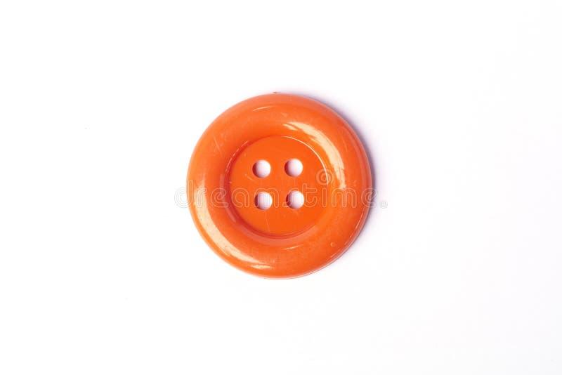 L'orange de vue supérieure colore de grands boutons photographie stock