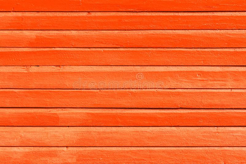 L'orange a peint le fond, la texture ou le mur en bois photo libre de droits