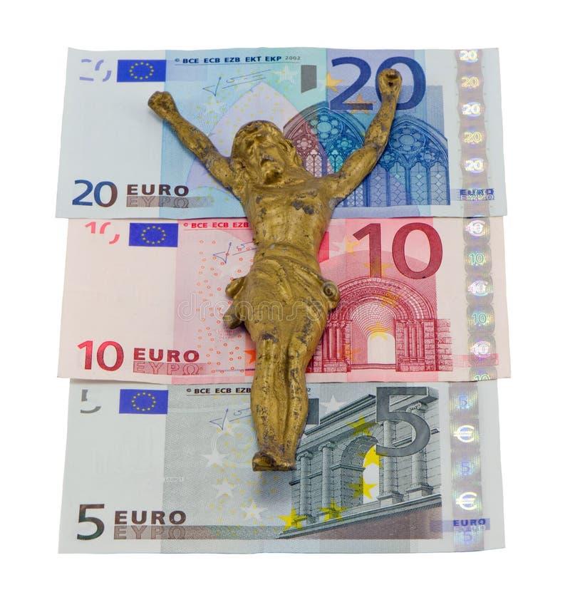 L'oro jesus di concetto crucify le euro banconote isolate fotografia stock libera da diritti