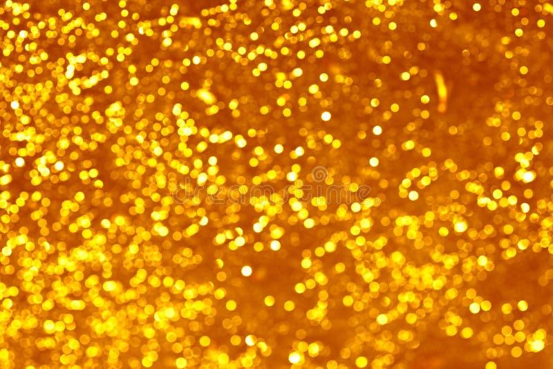 L'oro macchia il bokeh immagine stock
