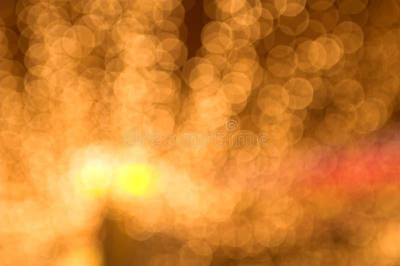 L'oro macchia il bokeh fotografie stock