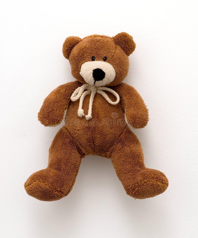 L'orsacchiotto riguarda un bianco immagine stock libera da diritti