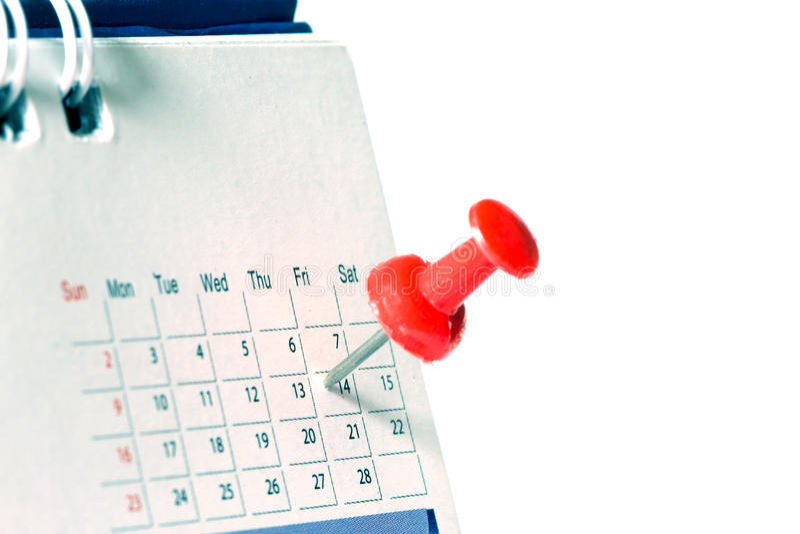 L'a pressione rosso alla pagina del calendario per ricorda a ed importante segnato fotografia stock