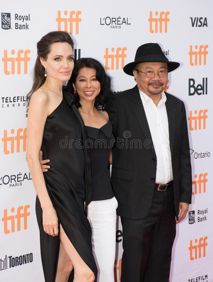 Angelina Jolie World Premiere of `First They Killed My Father` at Toronto International Film Festival. L-R Angelina Jolie, Loung Ung, and actor Rithy Panh at the stock photography