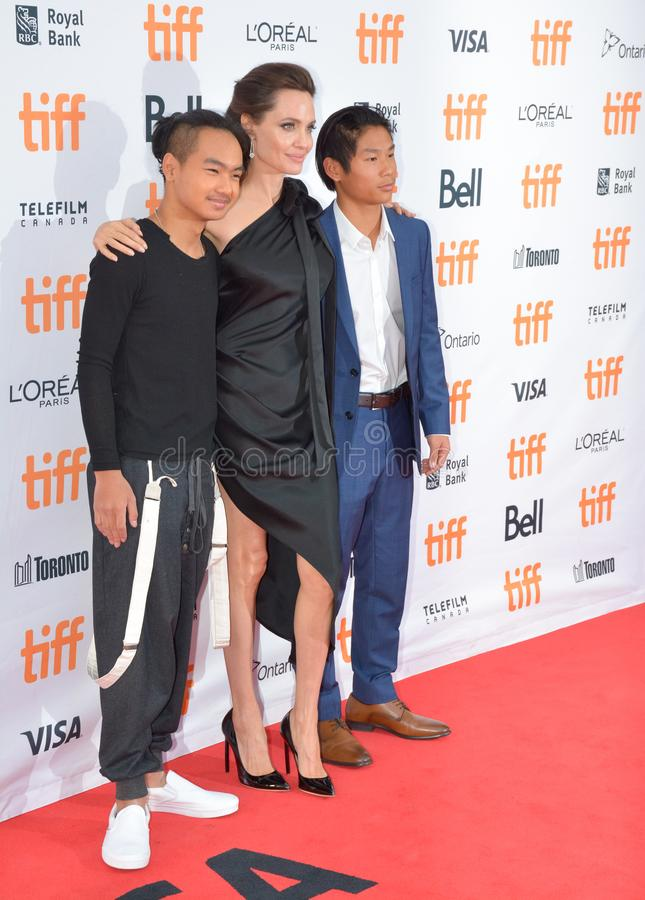 World Premiere of `First They Killed My Father` with Director Angelina Jolie at Toronto International Film Festival. L-R Maddox Jolie-Pitt, Angelina Jolie, and royalty free stock image