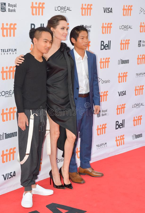 Angelina Jolie at`First They Killed My Father` with Director Angelina Jolie at Toronto International Film Festival. L-R Maddox Jolie-Pitt, Angelina Jolie, and stock image