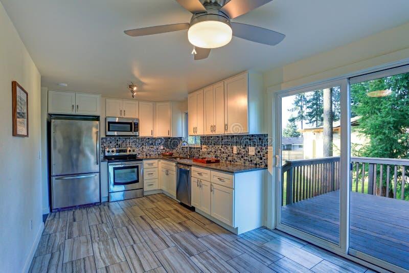 L-shape kitchen room design stock photo