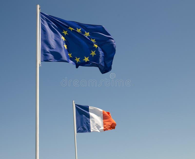 L'UE diminuent et le drapeau français photo libre de droits