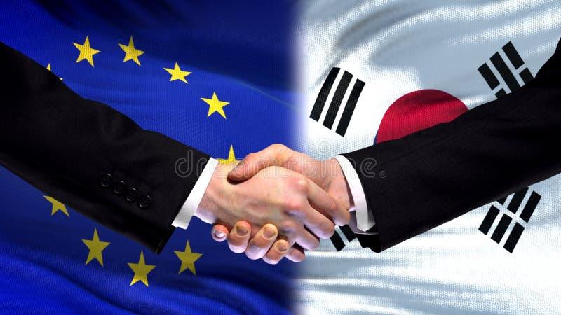 L'UE et la poignée de main de la Corée du Sud, des relations internationales d'amitié marquent le fond photos stock