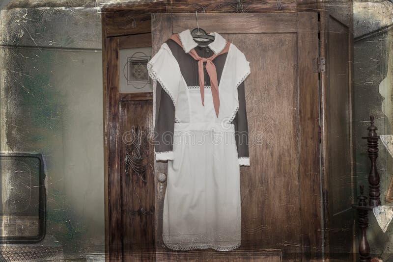 L'uniforme scolaire soviétique avant avec un lien pilote image stock