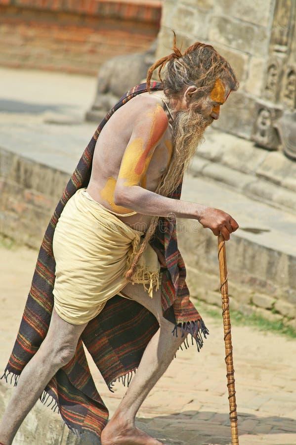 Download L'uomo Anziano Verniciato Chiede La Carità Nelle Tempie Nepal Immagine Stock Editoriale - Immagine di sociale, kathmandu: 21550129