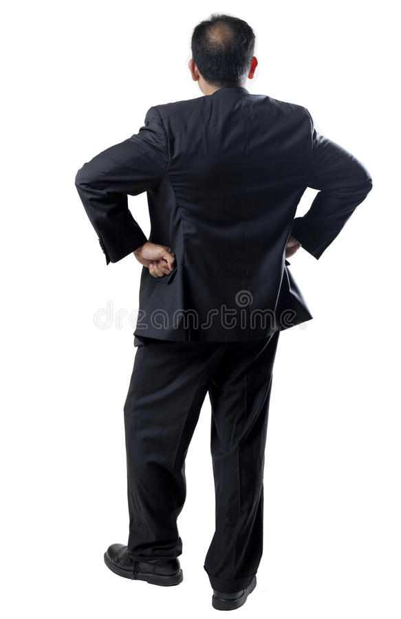 L'uomo Balding in vestito munisce Akimbo fotografia stock libera da diritti