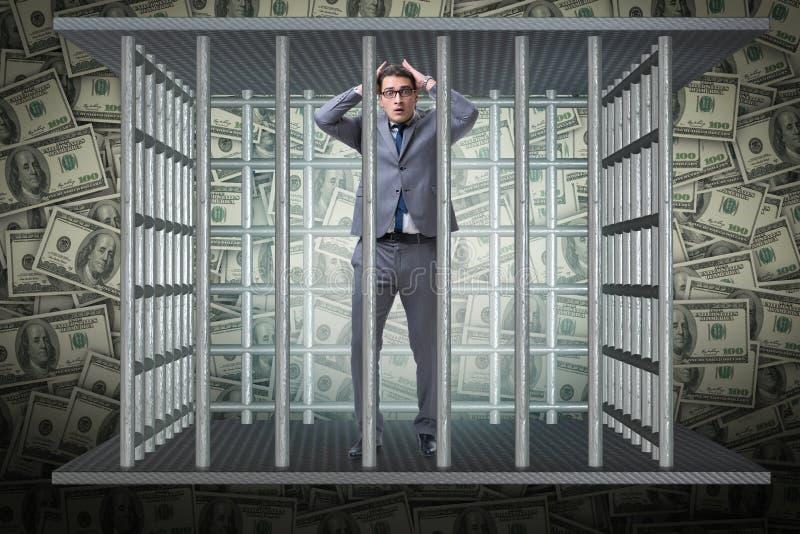 L'uomo bloccato in prigione con i dollari immagine stock