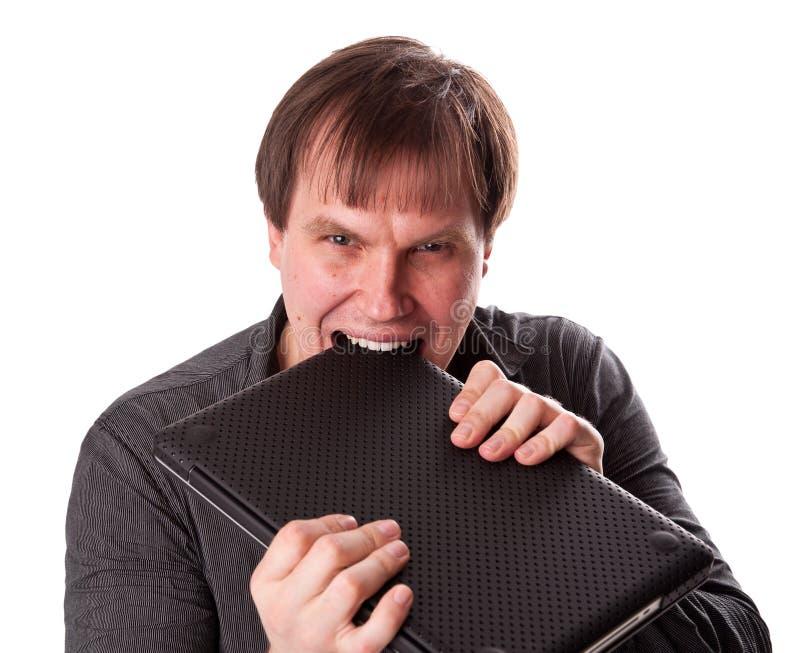 L'uomo con il computer portatile fotografia stock libera da diritti