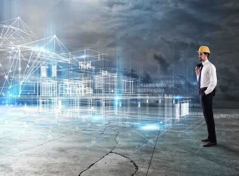 L'uomo d'affari Architect analizza un progetto di una costruzione fotografia stock