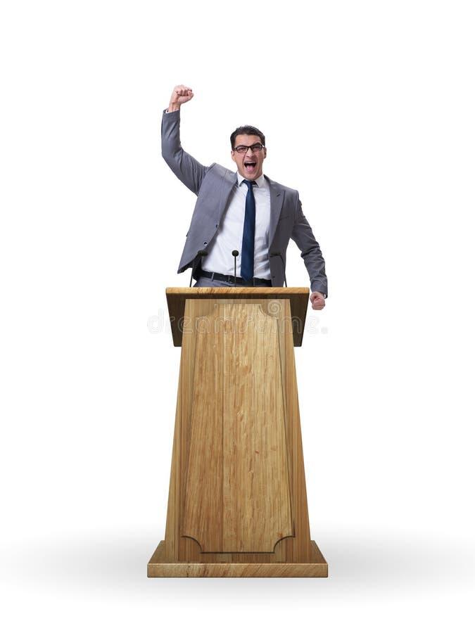 L'uomo d'affari che fa un discorso nel concetto di affari fotografia stock