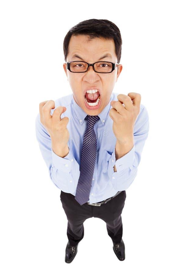 L'uomo d'affari che urla e fa un pugno Isolato su bianco immagine stock