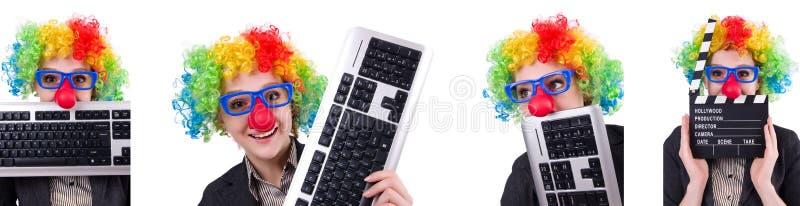 L'uomo d'affari con la parrucca del pagliaccio isolata su bianco immagine stock libera da diritti