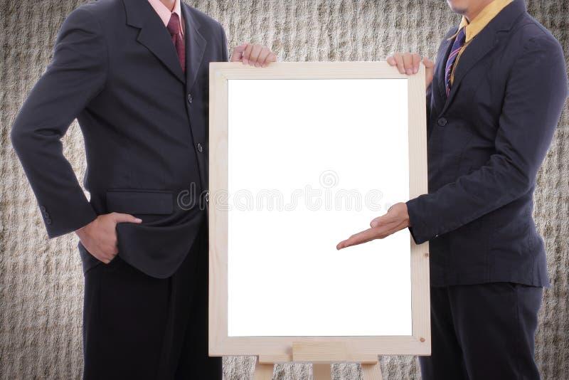 L'uomo d'affari discutono e la vetrina al cliente con il bordo bianco immagini stock