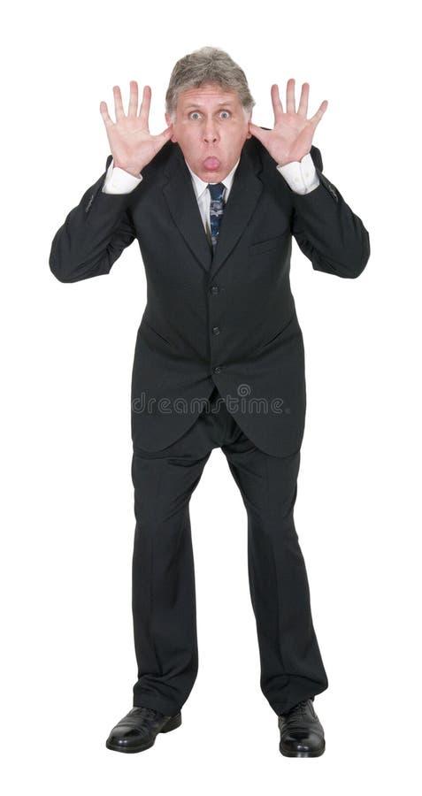 L'uomo d'affari divertente attacca fuori la lingua isolata immagine stock