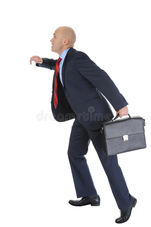 L'uomo d'affari funziona sulla scaletta di carriera fotografia stock
