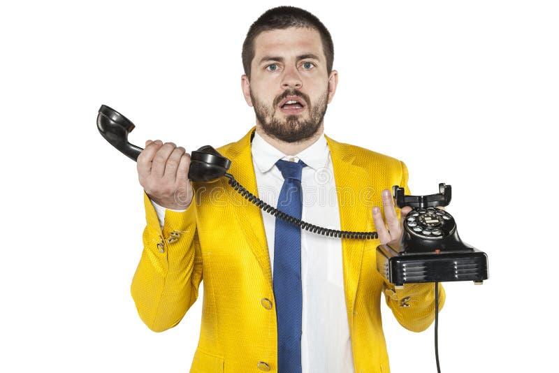L'uomo d'affari non sa il vecchio telefono fotografia stock