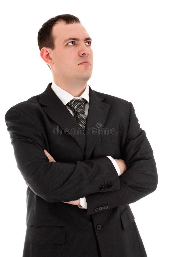L'uomo d'affari serio osserva in qualche luogo immagine stock