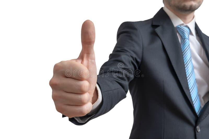 L'uomo d'affari sta mostrando i pollici sul gesto Isolato su priorità bassa bianca immagini stock libere da diritti