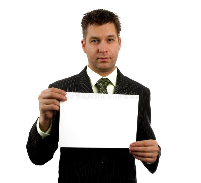 L'uomo d'affari sta tenendo la scheda vuota fotografia stock