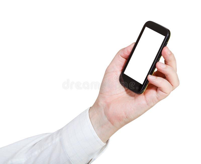 L'uomo d'affari tiene lo Smart Phone con lo schermo tagliato fotografie stock