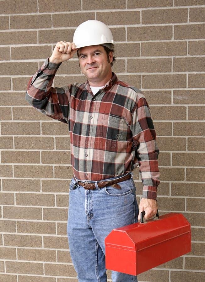 L'uomo di funzionamento capovolge il cappello fotografie stock libere da diritti
