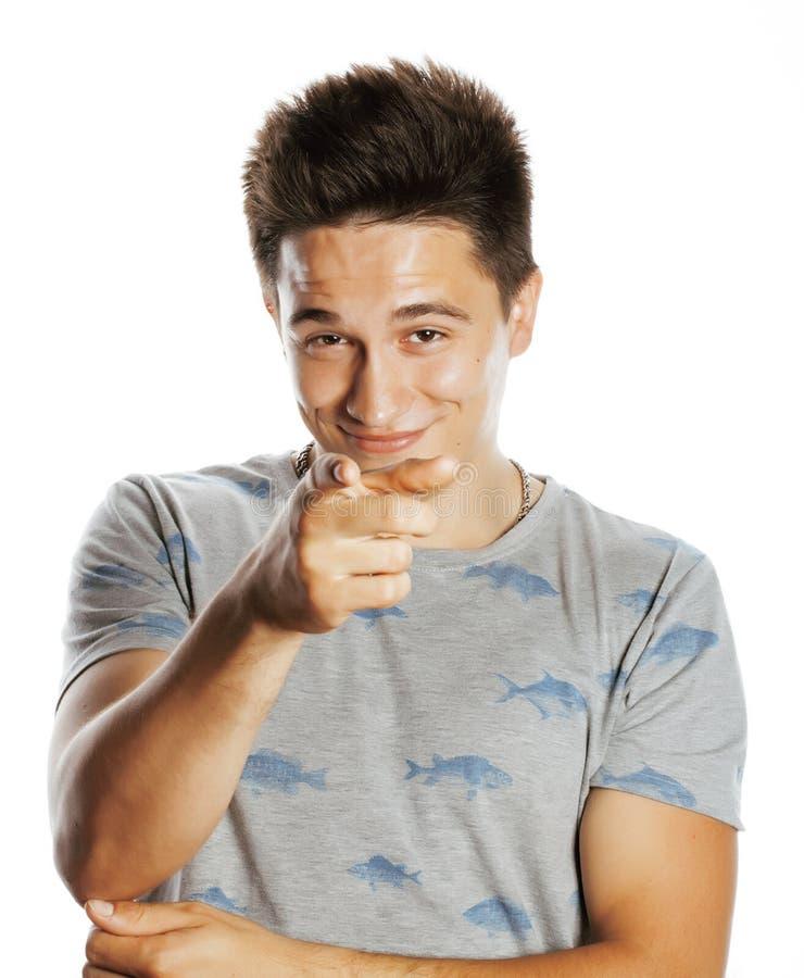L'uomo grazioso giovane che indica il dito voi ha isolato fotografia stock