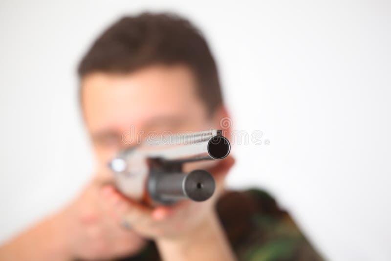 L'uomo ha indicato dalla pistola immagine stock libera da diritti