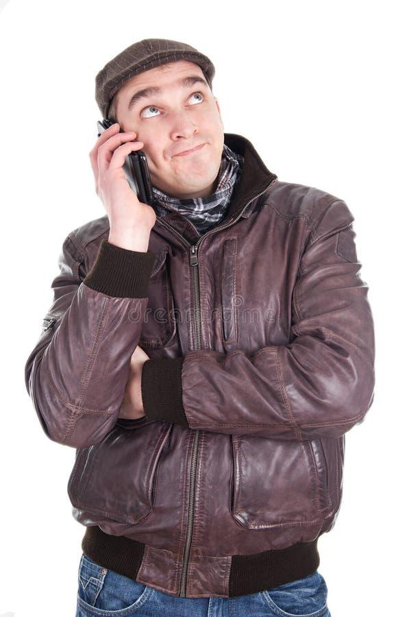 L'uomo ha una telefonata fastidiosa immagini stock