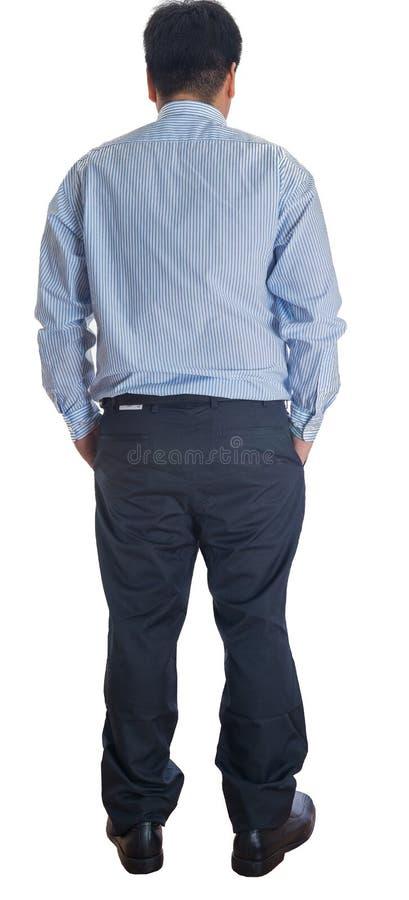 L'uomo posteriore di affari di vista considera la parete. fotografie stock libere da diritti