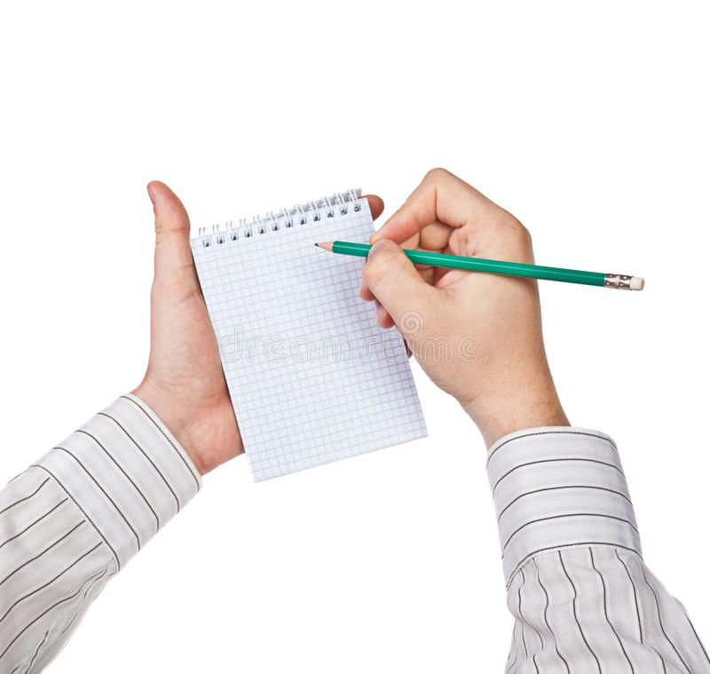 L'uomo scrive in un taccuino immagini stock