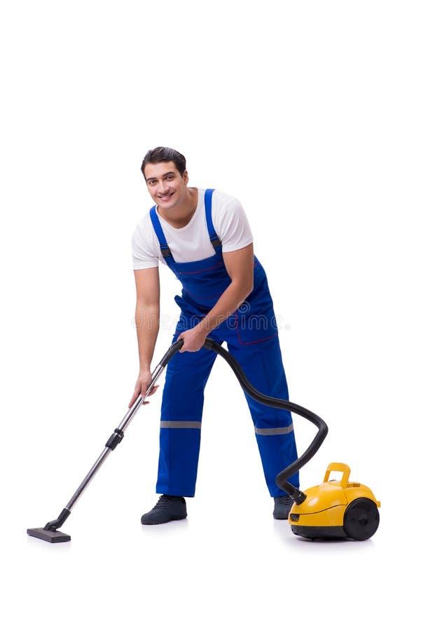 L'uomo in tute che fanno pulizia di vuoto sul bianco fotografia stock libera da diritti
